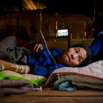 Sick village Akha tribe woman with IV in arm hospital, Kengtung, Myanmar Jocelyn Voo travel photography
