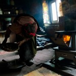 Tibetan woman cooking Tagong China