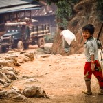 Myanmar photography. Boy fetching water.