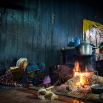 Myanmar photography. Woman sleeping in house.