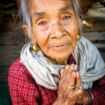 Nepalese woman praying portrait