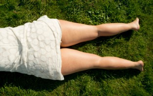 woman's legs on grass
